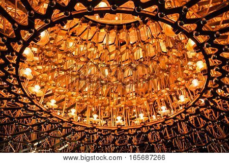 Hive of light and steel illuminated at night. Lights and steel are constructed in a form of hive and illuminated at night symbolising natural hive