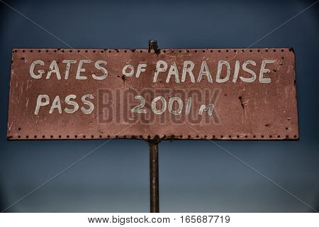 In  Road Sign Gate Of Paradise Pass