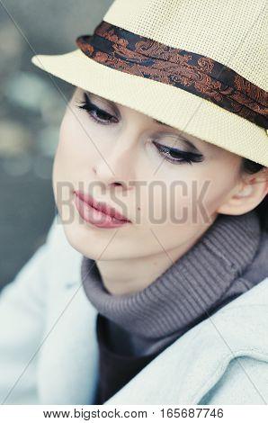 gentle portrait of beautiful woman in hat in retro style
