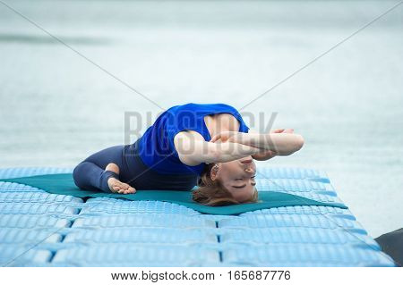 Young Woman Doing Yoga Exercise On Mat 24