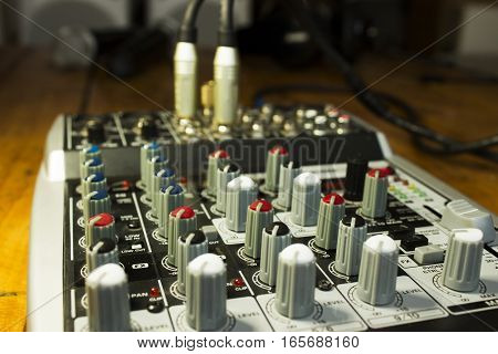 Detail Of A Music Mixer Desk With Various Knobs. Dj Mixing Console