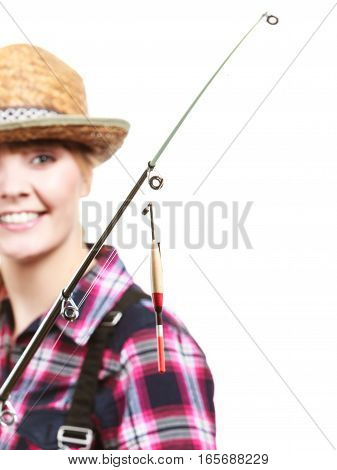 Spinning angling cheerful fisherwoman concept. Happy woman in sun hat holding fishing rod and looking at float