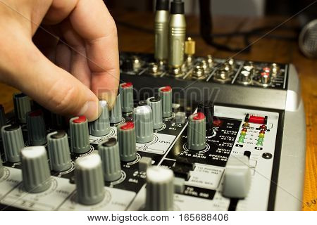 Dj Mixing Music On Console.