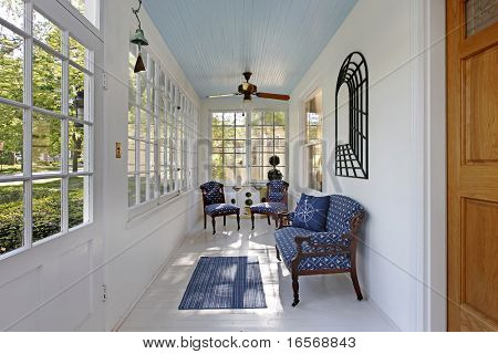 Porch with wall of windows and blue ceiling