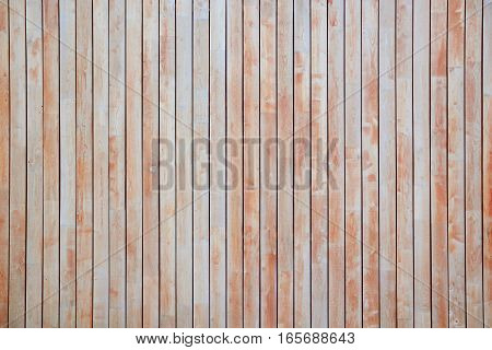 Red wooden background. Textured rustic planks vertically disposed.