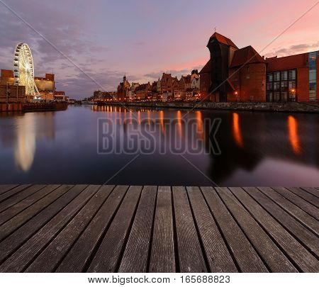 Background with wooden floors and Gdansk cityscape after sunset. Poland Europe.