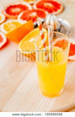 Glass Of Fresh Orange Juice With Drinking Straw