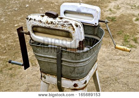 An old washing machine with two wringers and a galvanized tub.