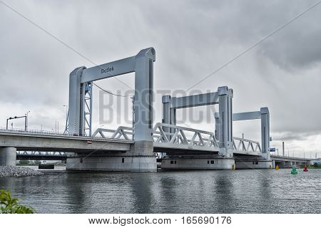 ROTTERDAM NETHERLANDS - MAY 5 2016: Botlek Bridge in the Rotterdam harbor area. The Botlek bridge is a combined lift over the Old Maas river which opened in 1955 and was replaced by a new bridge in 2015