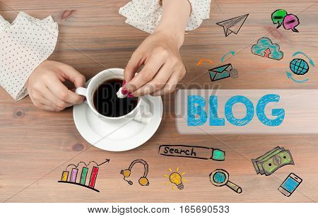 Blog concept. Coffee cup top view on wooden table background.