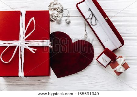 Stylish Red Present And Heart And Luxury Jewelry  Accessories On White Rustic Wooden Background. Hap