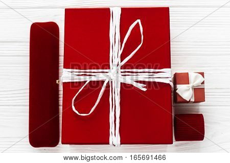 Stylish Red Present And  And Luxury Jewelry  Boxes On White Rustic Wooden Background. Happy Valentin