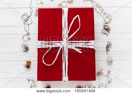 Stylish Red Present And Luxury Expensive Jewelry  On White Rustic Wooden Background. Happy Valentine