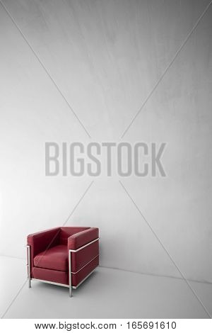 Red armchair in interior, modern European furniture on white wall, minimalist interior with armchair, sit down please