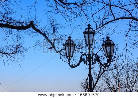 Antique lamp on seaside boulevard in Odessa Ukraine.