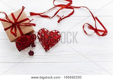 Stylish Craft Present Box And Hearts Roses Flat Lay On White Wooden Background. Happy Valentines Day