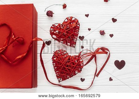 Stylish Present Box And Hearts Roses Flat Lay On White Wooden Background. Happy Valentines Day Conce