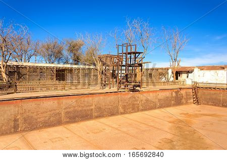 Empty swimming pool in the ghost town of Humberstone Chile