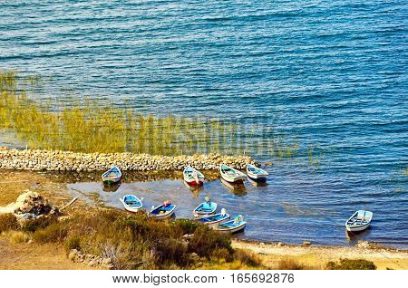 Twn small boats on the shore of Lake Titicaca on the Island of the Sun in Bolivia