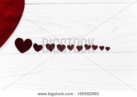 Stylish Velvet Hearts In Line  Flat Lay On White Wooden Background. Happy Valentines Day Concept. Gr