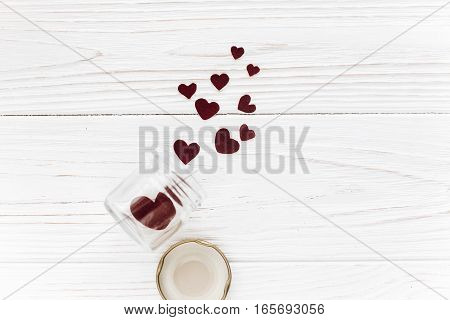 Happy Valentine Day. Stylish Hearts In Glass Jar  On White Wooden Background. Unusual Card. Greeting