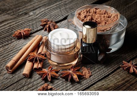Chocolate Skin Treatment. Cosmetic Jar With Cocoa, Lotion And Serum, Cinnamon Sticks, Anise.