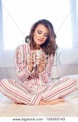 girl pyjamas bed morning cup of coffee