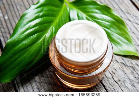 Cosmetic Bottle Container With Green Herbal Leaves, Blank Label For Branding Mock-up,
