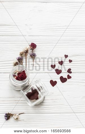 Happy Valentine Day. Stylish Hearts In Glass Jar And Roses Flat Lay On White Wooden Background. Unus