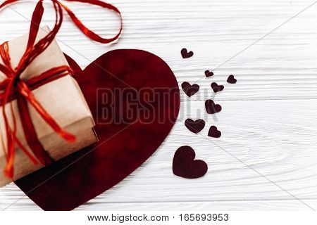 Valentine Concept. Stylish Present Box And Velvet Hearts On White Wooden Background. Happy Valentine