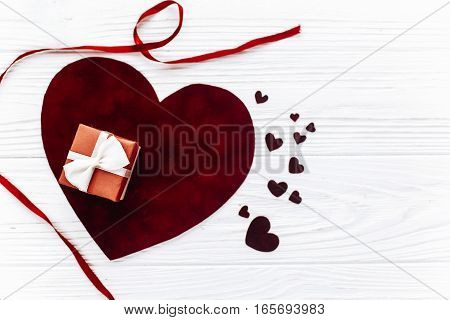 Valentine Concept Flat Lay. Stylish Present Box And Velvet Hearts On White Wooden Background. Happy