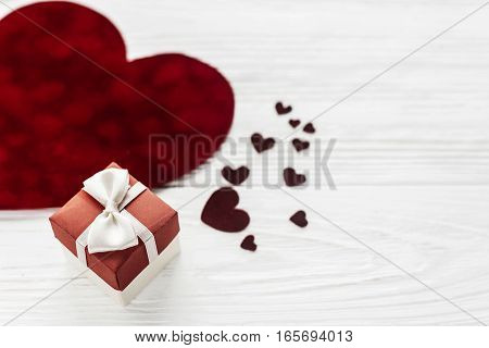 Stylish Present Box And Velvet Hearts On White Wooden Background. Happy Valentines Day Concept. Gree