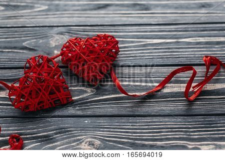 Stylish Two Red Hearts Ribbons On Black Rustic Wooden Background. Happy Valentines Day Concept. Gree