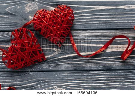 Valentine Concept. Stylish Two Red Hearts Ribbons On Black Rustic Wooden Background. Happy Valentine