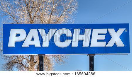 MENDOTA HEIGHTS MN/USA - JANUARY 14 2017: Paychex exterior sign and logo. Paychex Inc. is an American provider of payroll human resource and benefits outsourcing services.