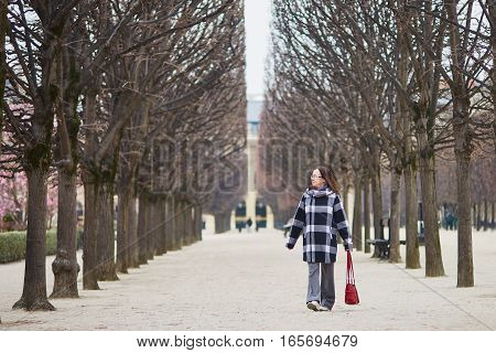 Beautiful Middle Aged Woman Walking In Parisian Park