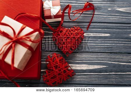 Stylish Red Present And Heart Ribbons Flat Lay On Black Rustic Wooden Background. Happy Valentines D