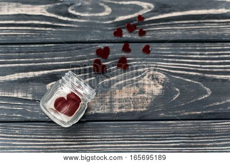 Stylish Velvet Hearts In Glass Jar  Flat Lay On Black Rustic Wooden Background. Happy Valentine Day.