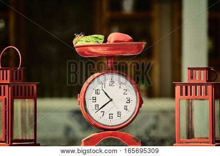 Old Clock Stylized Like Retro Scale with Vegetables on them