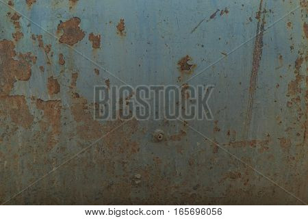old rusty metallic background on the street in winter