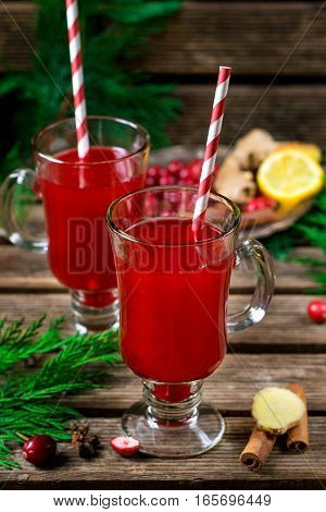 Winter cranberry drink with ginger spices and rum
