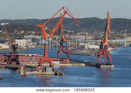 Orange cranes in the harbor, Gothenburg in Sweden