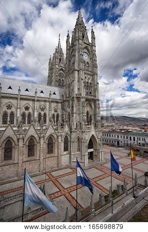 flags by the basilica de voto nacional Quito a neo-gothic style architecture