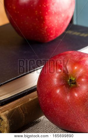 Fragment Of Old Books In Hardcover And Close-up Red Apple