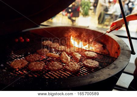 Delicious Meat Grilling With Flames And Smoke. Catering In Food Court At Mall. Space For Text. Open