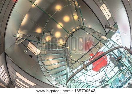Hong Kong, China - December 4, 2016: fish-eye interior prospective view inside Apple store in IFC Mall with glass stairway prospective from bottom to ceiling.