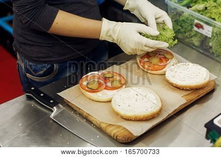 Process Of Making Burger. Chef Hands In Gloves Cooking Hamburgers And Cheeseburgers, Putting Ingridi