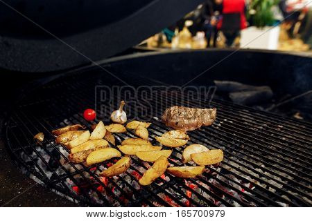 Potatos Meat Garlic And Tomato Pepper Grilling. Catering In Food Court At Mall Concept. Space For Te