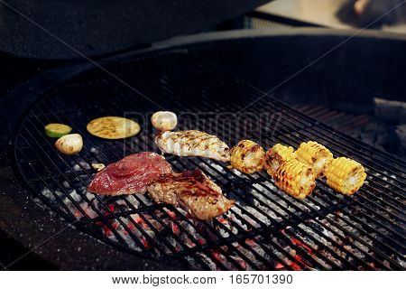Vegetables And Meat Grilling.  Mushrooms Corn Pepper Tomatos Garlic On Grill. Catering In Food Court