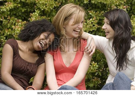 Happy diverse group of women laughing together.